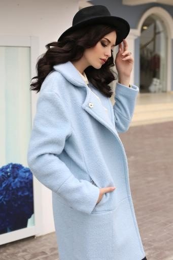 sensual woman with dark hair in elegant clothes and luxurious coat